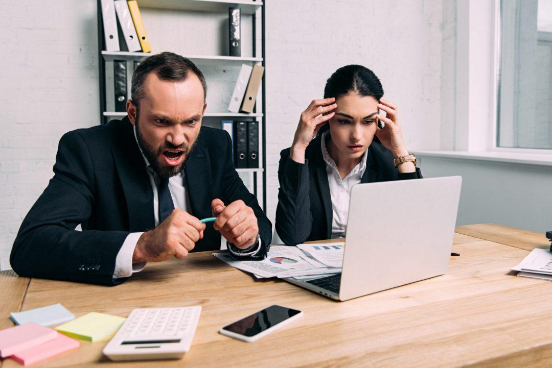 Stressed people at work.